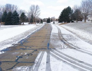 A local subdivision that was anti-iced in one lane prior to a minor winter event, using a blend produced in-house. (Photo provided)