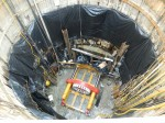 Construction crews place the tunnel boring machine in a pit adjacent to Lake Huron.
