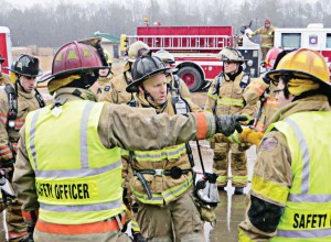 Participants in a KTF burn discuss at length the science behind fire behavior and how adjusting their responses to the details of a fireground situation might control it more effectively.