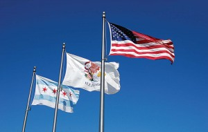 The Chicago flag has long been hailed as an ideal design. The stripes represent the sides of the city and its demarking bodies of water. The stars represent a founding event, the Chicago Fire, the World's Columbian Exposition and the Century of Progress Exposition. The image is flown all over the city today. (Shutterstock photo)