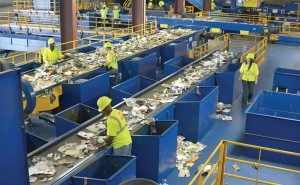 Workers in a material recovery facility keep their eyes on the recycled material going through the automation process to make sure no contaminated material gets through. (Photo courtesy National Waste and Recycling Association)