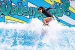 A patron enjoys FlowRider, a simulated surf machine at the Carmel Clay Parks