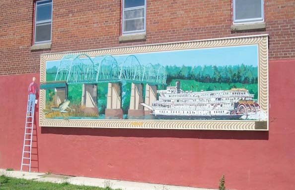 Downtown Louisiana, Mo., boasts more than 20 murals depicting the town's history, river heritage and local sights. This one was created by hometown artist John Stoeckley, one of the founders of the 50 Miles of Art festival.