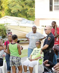 Lt. Mark Von Behren, New Bern, N.C., interacts with members of the North Hills community. Members of the public may be able to add data or other information relevant to the DDACTS model, promote the initiative and can express their reaction to the increase in enforcement. This support encourages the use of DDACTS as a strategy to improve the quality of life in neighborhoods that suffer from high crash and crime rates. (Photo provided)