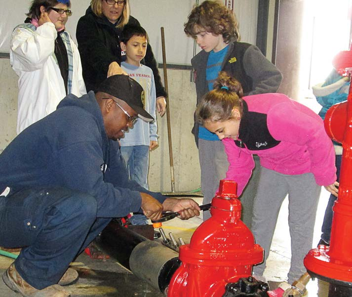 Children seemed to think that the Lake in the Hills, Ill., Public Works Open House was a bucket of fun. (Photo provided)
