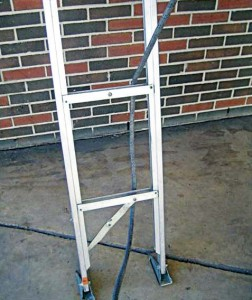 Attach a carabineer to the end of a rope and run it behind the bottom two rungs of the ladder. Then run the rope all the way up and over the highest rung possible. Lower the rope down to the window where the RIT crew connects the carabineer to the converted SCBA pack and helps guide the firefighter out the window. (Photo provided)