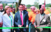 A ribbon cutting took place in August 2012 of a Pensacola Energy/ ECUA CNG station. Pictured in front, from left , are: Elizabeth Campbell, ECUA board member District 1; Pensacola Mayor Ashton Hayward; and Elvin McCorvey, ECUA board member District 3. (Photo provided)