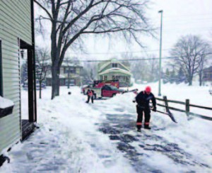Greenfield, firefighters and paramedics returning to the scene of a call to finish shoveling and plowing a local gentleman's drive. The kindness went viral worldwide, with a call to #ShovelItForward. (Photo provided)