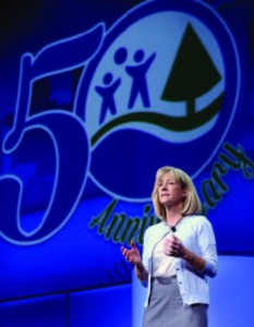 New Chairman of the Board of Directors Susan Trautman, CPRP, of Great Rivers Greenway District, St. Louis, Mo., greets attendees at the 50th anniversary National Recreation and Park Association Conference. (Photo courtesy Caught in the Moment Photography
