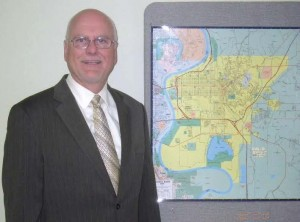 Council Bluffs, Iowa, Public Works Director Greg Reeder poses with a map of the city. (Photo provided)