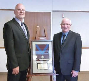 Reeder, left, and Larry Stevens, APWA president, during the APWA conference at which Reeder was named one of 2015 Top Ten Public Works Leaders. (Photo provided)
