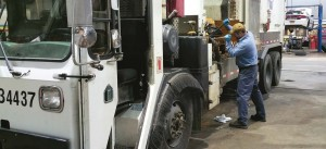 Durham, N.C., Master Mechanic Jorge Heavlin works on an automated refuse collection vehicle. (Photo provided)