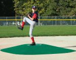 A young baseball player prepares to pitch on the True Pitch 202–6 Mound. True Pitch mound products are the only portable mounds approved by Little League for official game use. (Photo provided)
