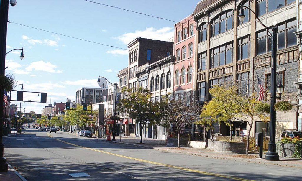 """George F. Johnson was a partner in the highly successful Endicott- Johnson Shoe Company, which established the Triple Cities of Binghamton, Johnson City and Endicott in New York. Pictured is downtown Binghamton, which is known as the """"Carousel Capital of the World."""" (Public domain via Wikimedia Commons)"""