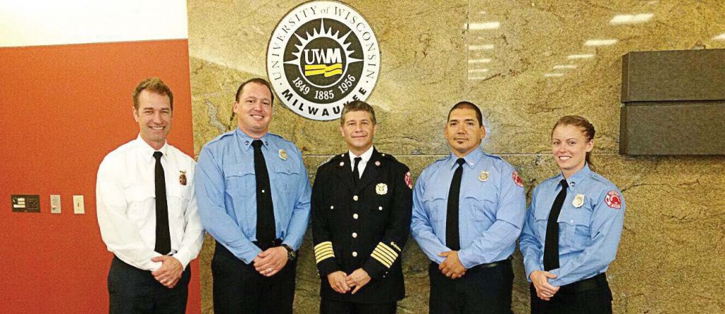 Chief Jon Cohn of Greenfield Fire-Rescue, center, stands with the department's first four community paramedics at their graduation at the University of Wisconsin-Milwaukee. (Photo provided)