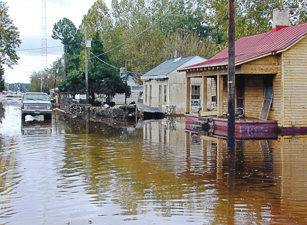 Princeville, N.C., was also impacted by Hurricane Floyd in 1999, pictured, with the resultant flooding of the Tar River forcing the evacuation of residents. (By Dave Saville/FEMA Photo Library via Wikimedia Commons)