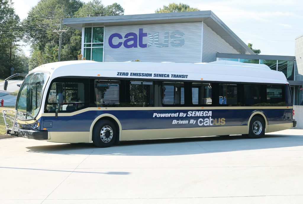 Seneca, S.C., has drawn visitors from all over the world and U.S. with its all-electric, batterypowered fleet of six buses — the first in the world. The buses have also brought sizable savings when compared to diesel buses. Pictured is one of the buses at Clemson Area Transit. (Photo provided)