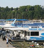Houseboat Row, a unique feature of the annual National On Water Houseboat Expo on Lake Cumberland, allows expo attendees to rent aquatic accommodations during the three-day festival. (Photo provided)
