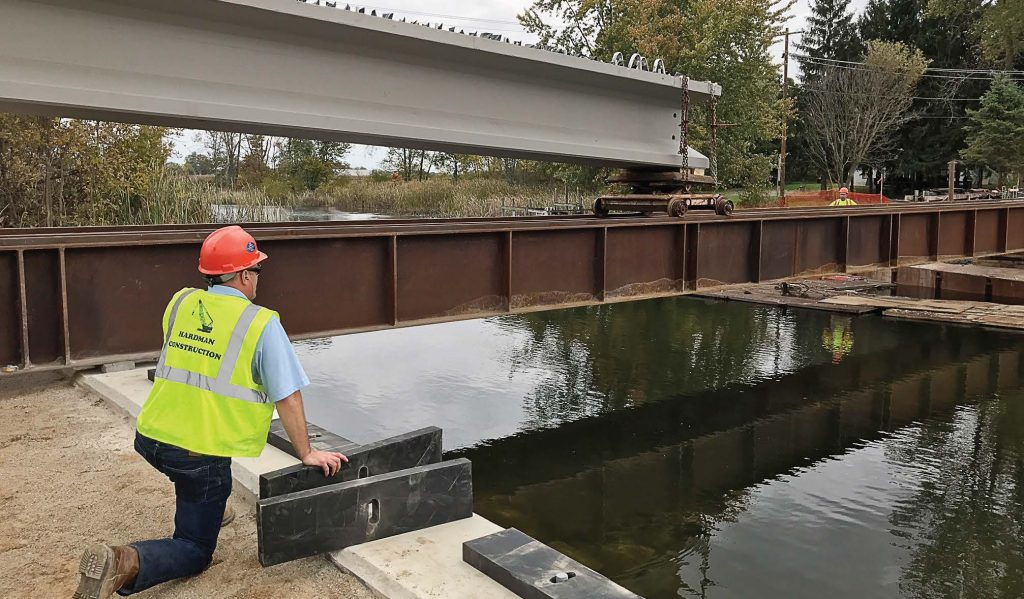 Workers get ready to place one of the new bulb T-beams at the M-86 bridge project site. The new M-86 bridge will be one of only two bridges in Michigan to feature the innovative bulb T-beams. (Photo provided)