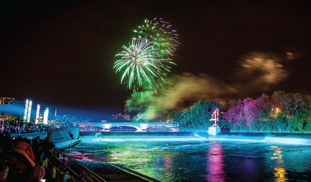"Downtown South Bend, Ind., has become a ""must-see"" destination, partially thanks to the River Lights. The lights turn the St. Joseph River and Riverwalk into a canvas that can also be interactive. It helps attract many summer festivals. (Photo provided)"