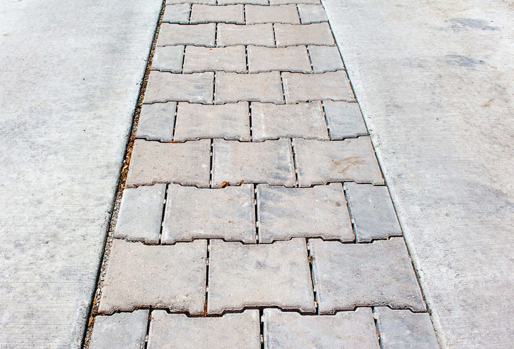 In order to combat flooding issues in Berwyn, Ill., the city researched various options, including green alley infrastructures. Pictured is a closeup of the material they are using to reconstruct their alleys. It allows stormwater to permeate the soil, reducing urban runoff. (Photo provided)