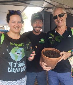 Members of Community Greening, a local nonprofit, hold saplings during Delray Beach's Earth Day celebration. The nonprofit has worked with Delray Beach's Parks and Recreation Department to help restore the city's urban tree-canopy. (Photo provided)