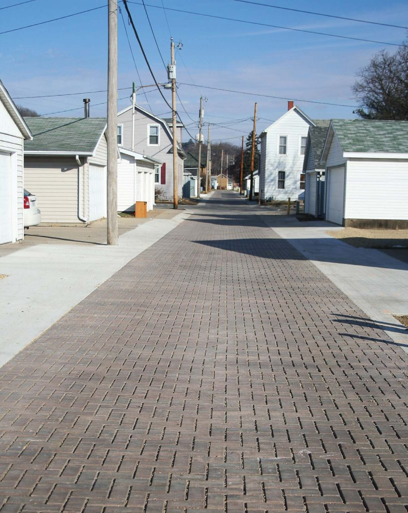 During a pilot program in Dubuque, Iowa, the city tried two different green alley options — porous asphalt and interlocking concrete pavers. The city collaborated with utility companies and chose to use the concrete pavers moving forward since it will be easier to correct future potential maintenance issues. (Photo provided by the city of Dubuque)