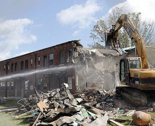 Northcott Court in the Fairfield West section of Huntington is demolished as part of its revitalization plan, which is designed to transform neighborhoods and blighted areas into hip hubs for innovative manufacturing, advancement training and healthy community improvements. (Photo provided)