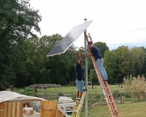 A small complete off-grid solar system was installed at the Buford Greenhouse at Buford Middle School in Charlottesville, Va. The system powers the greenhouse's ventilation fans and small additional appliances. (Photo provided)