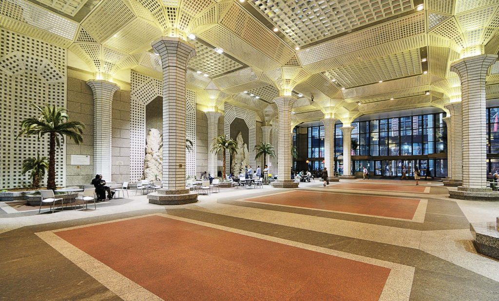 Within 60 Wall St Atrium in New York City, there is a 2,360-square-foot pedestrian arcade, which is a privately owned public space completed in 1989. The concept of POPS started in New York City, with plazas and arcades in the early '60s. (Shutterstock.com)