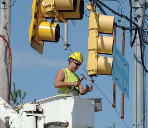 A Cranberry Township employee works on a traffic light. (Photo provided)
