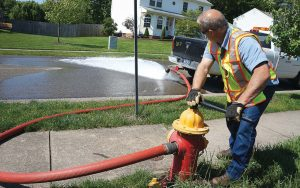 Local governments often have more of an impact on daily lives of citizens, through maintaining necessary infrastructure. Pictured, a Cranberry Township employee flushes a fire hydrant. (Photo provided)
