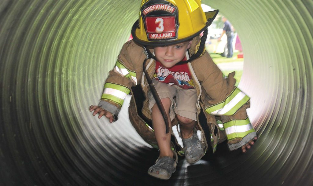 A potential future recruit for the Holland Fire Department participates in one of the activities held during Fire Prevention Week. (Photo provided)