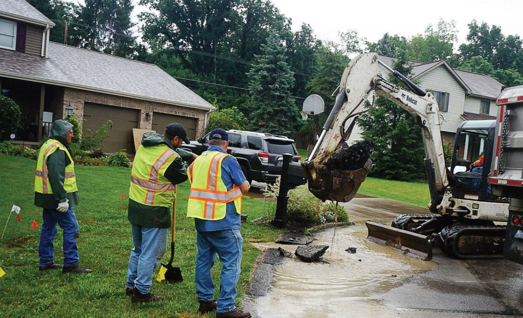 The integration of politics at a local level can prove to be a hindrance when providing citizens with quality services. There is no liberal or conservative approach to fixing a broken sewer line or to filling a pothole. Pictured, Cranberry Township public works employees repair a waterline break. (Photo provided)