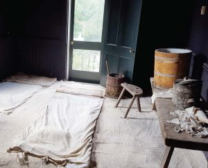 The patients' room at Pest House was painted black to alleviate light sensitivity in smallpox patients and white sand was used to trap germs. After each patient's stay, the sand was swept out the door. (Photo provided by Ted Delaney)