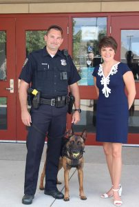 Kurovski hopes to help Pleasant Hill continue its high level of public safety services by building a new public safety facility. Here she stands with a local officer and his K-9. (Photo provided)