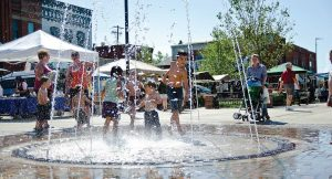 Kids play in the fountain at Stevens Point's farmer's market. (Photo provided by KT Elements)