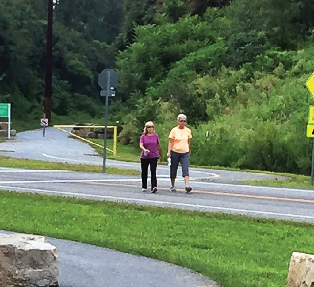 Two walkers enjoy the Enola Low Grade Trail, which nowadays connects Lancaster and Chester counties in Pennsylvania. (Photo provided)