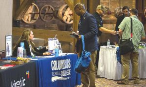 A public works employee checks out some college opportunities at an Up and Motivated conference. (Photo provided)