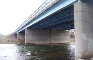 Pictured is the Harshman Road Bridge in 2011. Its deck had been falling apart while cracks had appeared in the pier and abutment walls. Erosion also posed a concern. (Photo provided)