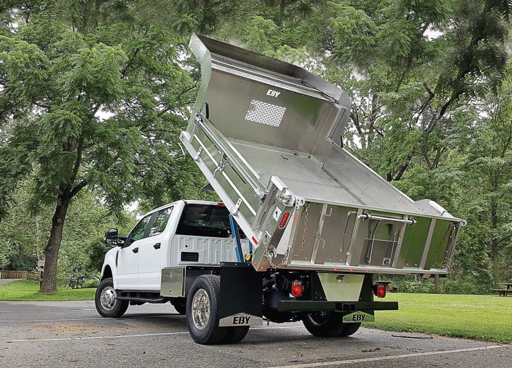 EBY's allaluminum flatbeds, dump bodies, stake bodies, service bodies and van bodies are lighter than steel, require less maintenance and are resistant to corrosion. Pictured is a general purpose dump body. (Photo provided)