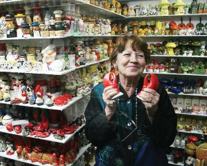 The late Andrea Ludden, cofounder and curator of the Salt and Pepper Shaker Museum, displays one of the more than 20,000 unique sets of salt and pepper shakers at her museum in Gatlinburg, Tenn. (Photo provided)