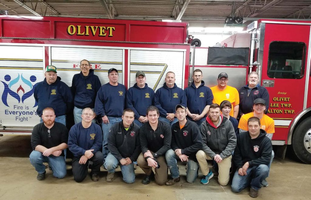Pictured are members of the Olivet Fire Department. One key to retention has been utilizing new volunteers on proactive projects like installing new fire and carbon carbon monoxide alarms for free. These projects create goodwill in the community while also making volunteers feel valued. (Photo provided)