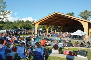Residents of Johns Creek enjoy a summer concert. Since its incorporation, Johns Creek has doubled its city park system. (Photo provided)