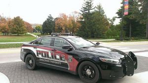 Iowa State University switched from two-tone police vehicles, right, to all-black vehicles, below, with decals. This change was made when it was noticed that two-tone vehicles didn't sell as well at auction. (Photo provided)