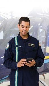 Phil Nicolas, a 21-year-old paramedic with LifeLink III, is pictured near one of the flight service's six AgustaWestland 119Kx helicopters at his base in Anoka, Minn. LifeLink III has found tracking schedules, swapping shifts and supervisor-staff communication to be easier with the Aladtec workforce management system.(Photo provided)