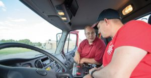 Fire Chief Scott Braith shows a volunteer firefighter around the cab of the new truck. (Photo provided)