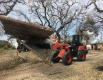 Kubota stepped up in the aft ermath of Hurricane Harvey, donating $1 million in relief funds and equipment to several national and local charitable organizations. Pictured is a Kubota tractor removing debris from Hurricane Harvey. (Photo provided)