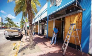 While agencies might seek out local sources, disasters might render local businesses unable to fulfill needs. In such cases, larger companies, with a national footprints, could bring in resources from other regions. Pictured are stores in Miami boarding up in preparation for Hurricane Irma. (Shutterstock.com)
