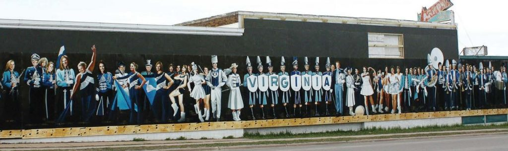 "The mural titled, ""Marching Blues: The Virginia Marching Band Through Time,"" contains the likenesses of high school band members through the years. (Photo provided)"